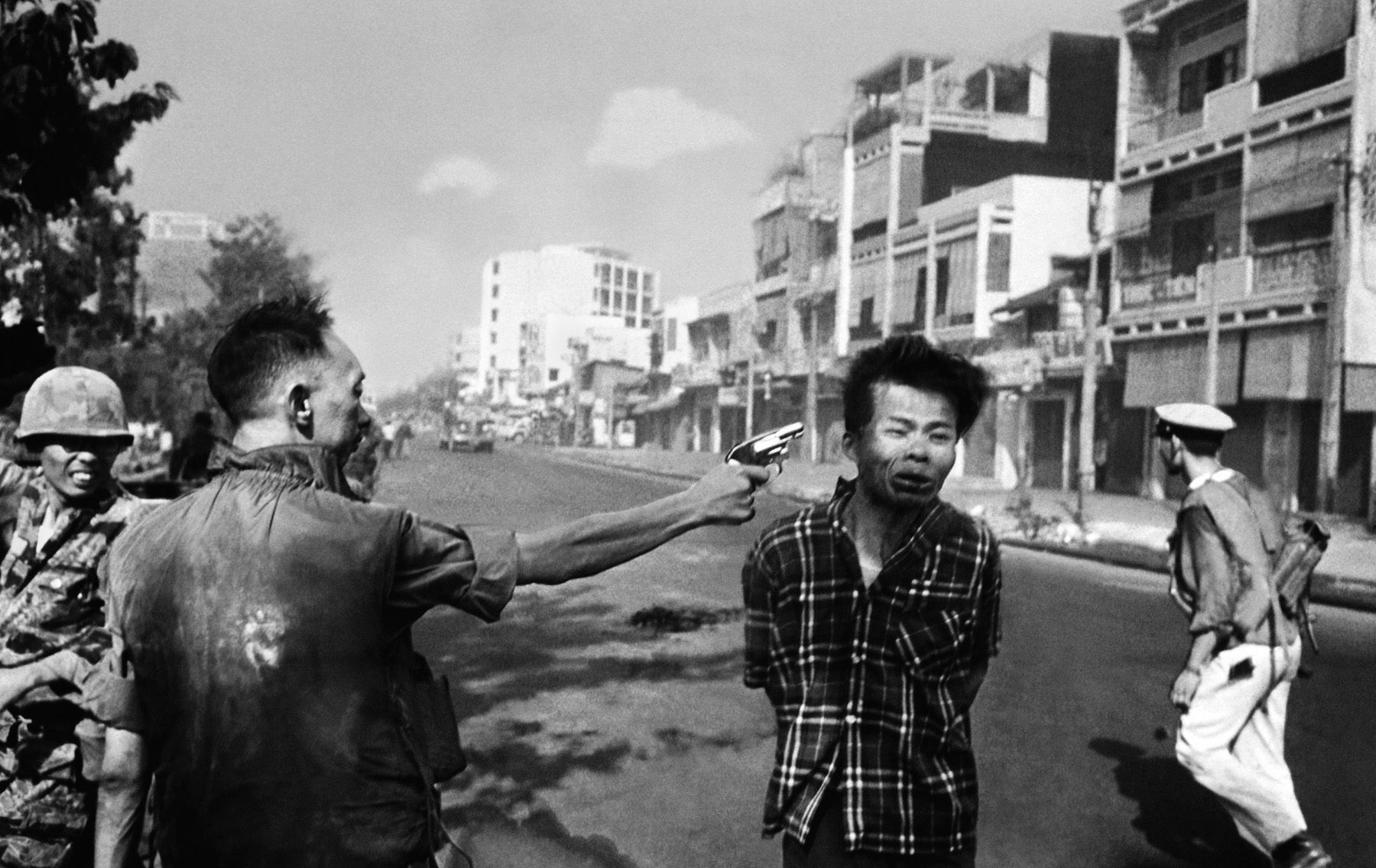 2. General Nguyen Ngoc Loan Executing a VietCong Prisoner in Saigon - Eddie Adams