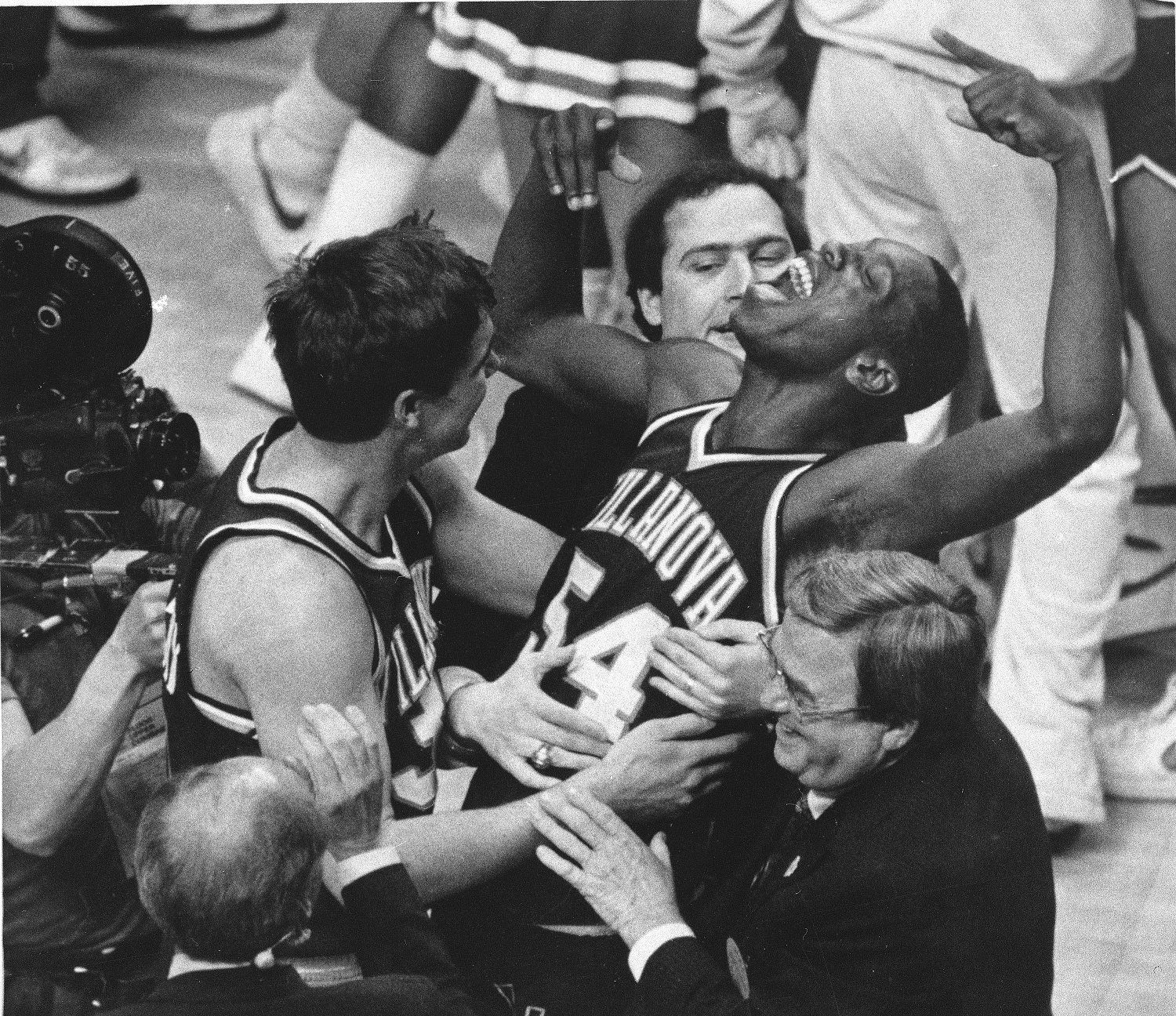 Villanova's Ed Pinckney (54) yells out as he is surrounded by teammates after the Wildcats defeated Georgetown and claimed the NCAA Championship in Lexington, Kentucky, April 1, 1985. (AP Photo/Gary Landers)