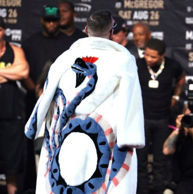 d5449f10eff39 He wore this custom Gucci mink coat during one of his press tours for UFC.  He has a flamboyant style he isn t afraid to show off. He likes to draw  attention ...