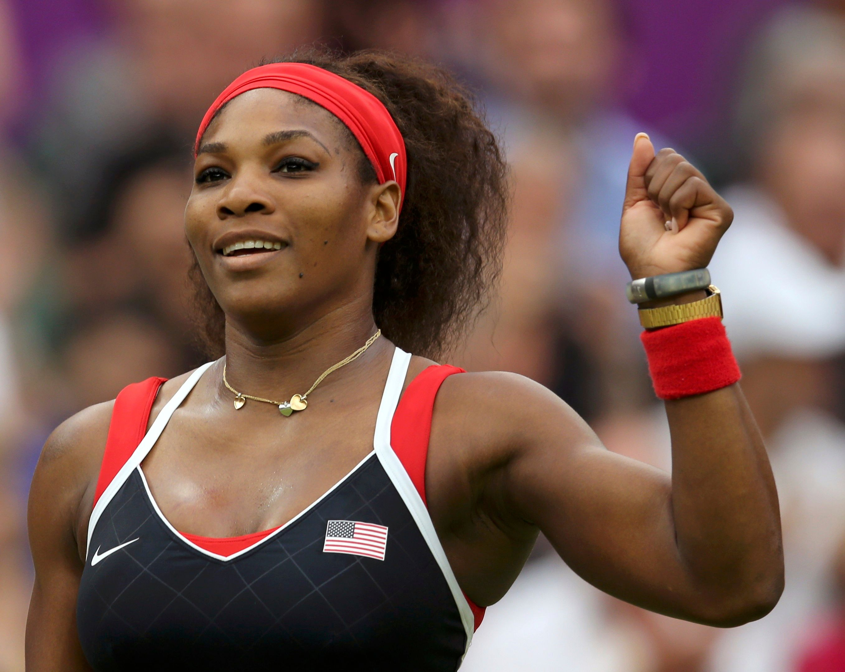 Serena Williams of the U.S. celebrates after defeating Russia's Zvonareva in their women's singles tennis match at the All England Lawn Tennis Club during the London 2012 Olympic Games